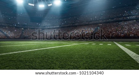 Dramatic 3D professional American football arena with green grass and rays of light Royalty-Free Stock Photo #1021104340