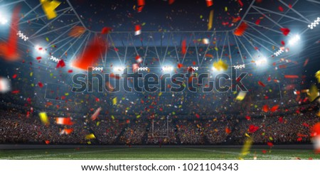 Dramatic 3D professional American football arena with green grass and rays of light Royalty-Free Stock Photo #1021104343