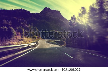 Road travel  concept.Adventures and escapade in journey.Sunset nature landscape and bend road.Safety and precaution driving #1021208029