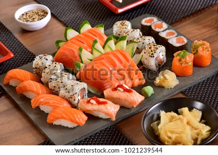 Mix of Japanese food on restaurant table #1021239544