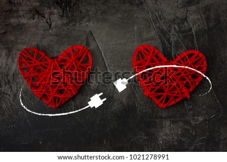 Two hearts connected by USB cable. Theme of love, wedding, Valentine's Day