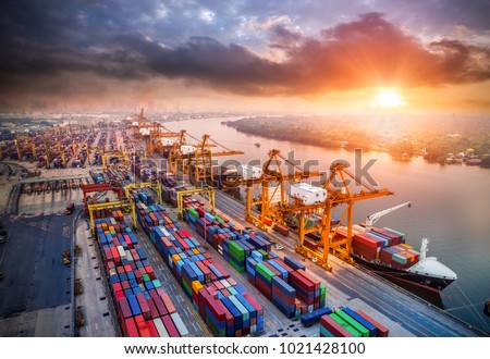 Logistics and transportation of Container Cargo ship and Cargo plane with working crane bridge in shipyard at sunrise, logistic import export and transport industry background #1021428100