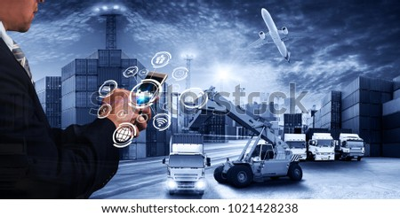 Business man point to the hologram on smartphone and Industrial Container Cargo freight ship, forklift handling container box loading for logistic import export and transport industry concept backgrou #1021428238