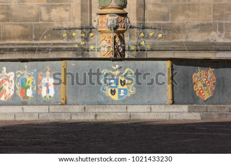 historical city schwaebisch gmuend catholic church details ornaments and roof in south germany sunny summer day #1021433230