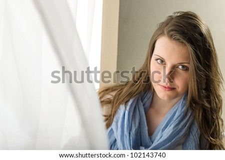Young woman brunette stand behind blowing curtain romantic purity #102143740