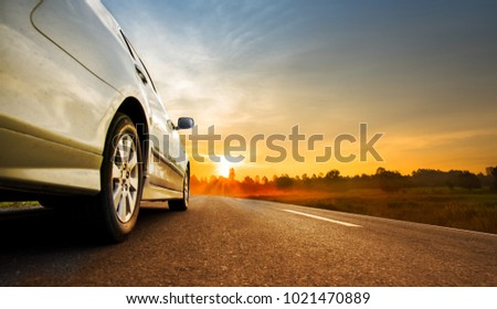 Tourism car on highway with sunset landscape #1021470889