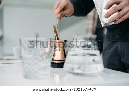 Making coffee in turkish coffee pot (cezve) #1021577479