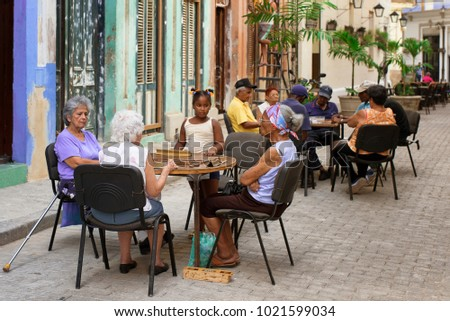 Havana, Cuba - August 3, 2017: elderly people playing domino game in the street #1021599034