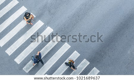 From the top view of people walk on street pedestrian crossroad in the city street ,bird eye view. #1021689637