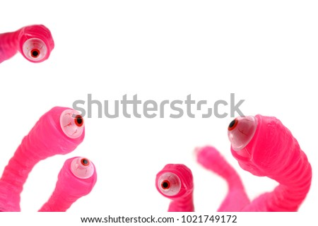 Alien eye stock images. Pink eyeballs stock images. Scary pink eyeballs on a white background. Crazy background with eyes