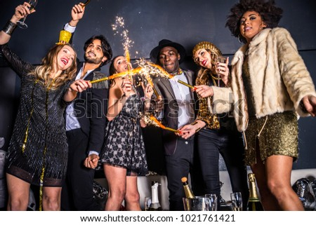 Multi-ethnic group of friends celebrating in a nightclub - Clubbers having party #1021761421