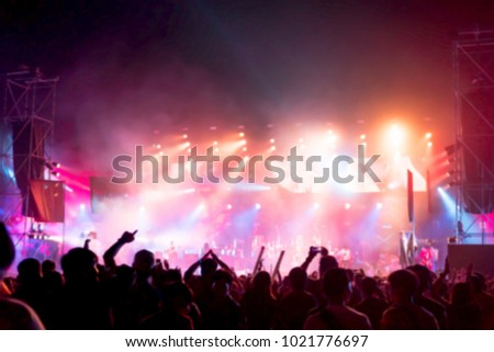 Blurred background : Bokeh lighting in outdoor concert with cheering audience #1021776697