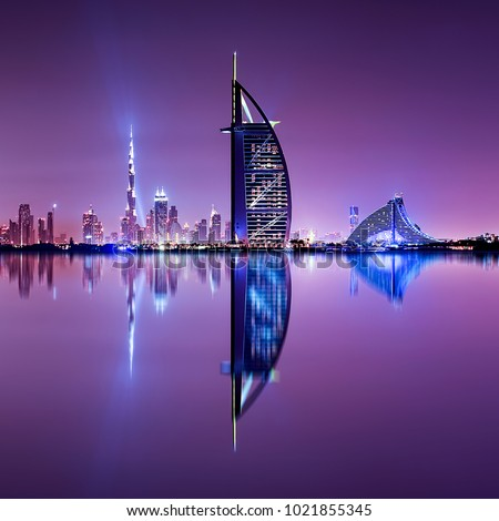 Detail of skyscraper reflection. Beautiful skyline scene in Dubai. Multiple highest buildings during night. The Palm island, United Arab Emirates. Royalty-Free Stock Photo #1021855345