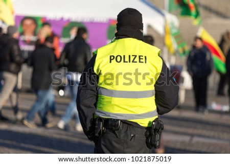 german police officer protecting a demonstration #1021875019