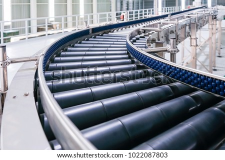 Crossing of the roller conveyor, Production line conveyor roller transportation objects. Royalty-Free Stock Photo #1022087803