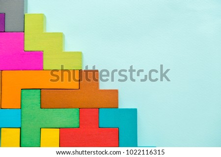 Wood block stacking as step stair. Step by step to the top on blue paper. Business growth concept picture.building success foundation process