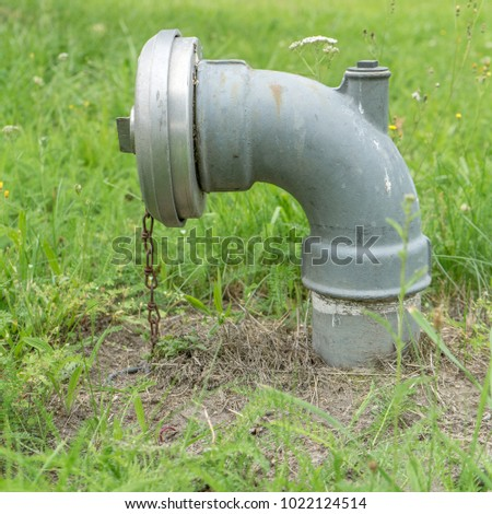 Water hydrant on a lawn  #1022124514