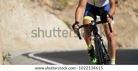 Road bike cyclist man cycling,athlete on a race cycle #1022134615
