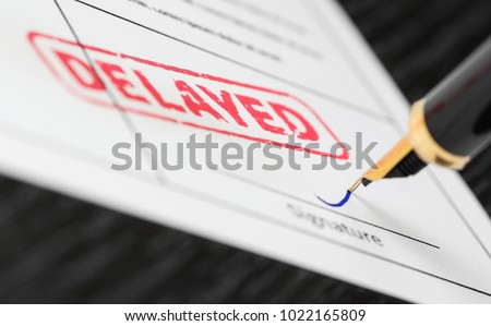 Seal delayed stamped on a document and fountain pen. Macro shot. Soft focus. Royalty-Free Stock Photo #1022165809