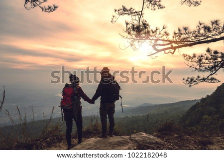 lover women and men asians travel relax in the holiday. Photograph mountain landscapes atmosphere in the morning. In the winter. In Thailand #1022182048