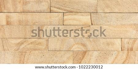 Texture of golden sandstone bricks #1022230012