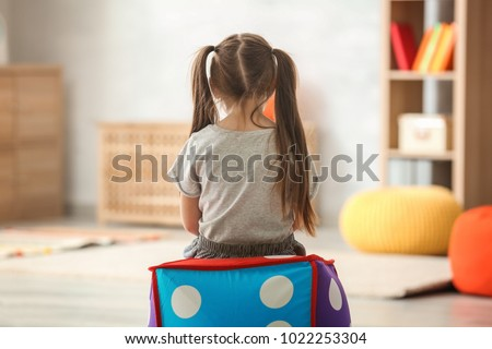 Lonely little girl at home. Autism concept #1022253304
