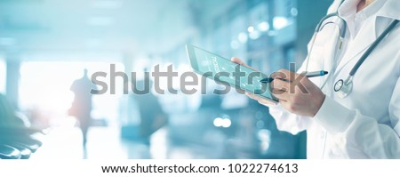 Medicine doctor and stethoscope touching icon medical network connection with modern interface on digital tablet in hospital background. Medical technology network concept Royalty-Free Stock Photo #1022274613