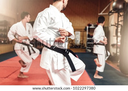 Martial arts fighters on workout in gym #1022297380