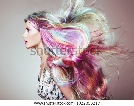 Beauty Fashion Model Girl with Colorful Dyed Hair. Girl with perfect Makeup and Hairstyle. Model with perfect Healthy Dyed Hair. Rainbow Hairstyles #1022353219
