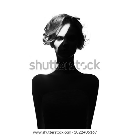 Black and white art fashion surrealistic portrait of beautiful woman with a beam of light on her face #1022405167