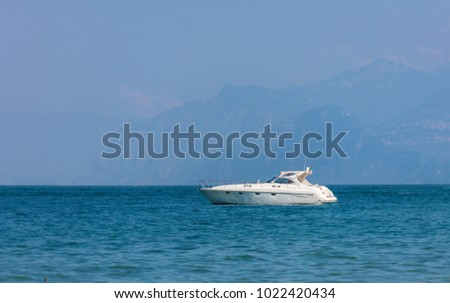 motor boat is floating along the coast #1022420434