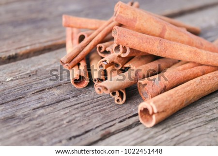Aromatic cinnamon sticks on a wooden background #1022451448