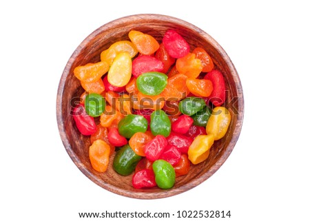 Dried colored kumquat in a wooden bowl isolated on white background top view #1022532814