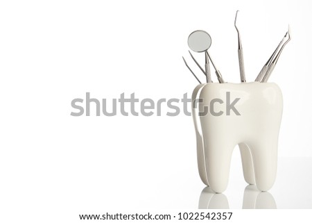 Dental tooth model with metal medical dentistry equipment tools for teeth dental care isolated on white background with copy space, close-up. Oral dental hygiene concept #1022542357