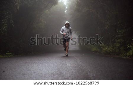 Running runner man sprinting workout on mountain road  #1022568799