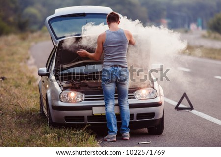 The car broke down, smokes from under the hood, the driver shocked #1022571769