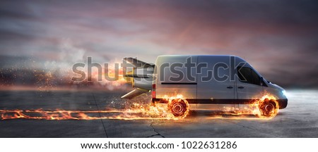 Super fast delivery of package service with van with wheels on fire Royalty-Free Stock Photo #1022631286