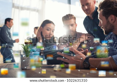 Businessperson in office connected on internet network. concept of partnership and teamwork Royalty-Free Stock Photo #1022631310