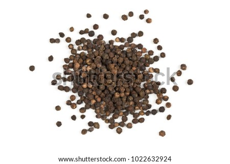 Heap of raw, natural, unprocessed black pepper peppercorns over white background #1022632924