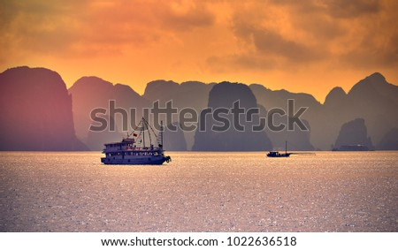 Tourist Junks in Halong Bay,Panoramic view of sunset in Halong Bay, Vietnam, Southeast Asia Royalty-Free Stock Photo #1022636518