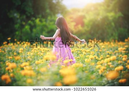 Little asian girl in flower fields, Outdoor portrait #1022651026