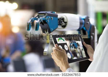 Industry 4.0 Robot concept .Engineers use laptop computers for machine maintenance, automation tools, robot arm at the factory.   #1022667853
