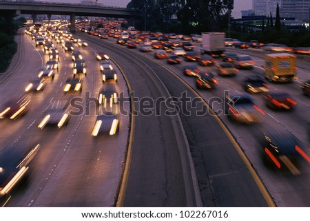 Heavy traffic on freeway at twilight #102267016