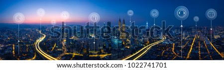 Panorama aerial view in the  cityscape skyline  with smart services and icons, internet of things, networks and augmented reality concept , early morning sunrise scene . Royalty-Free Stock Photo #1022741701