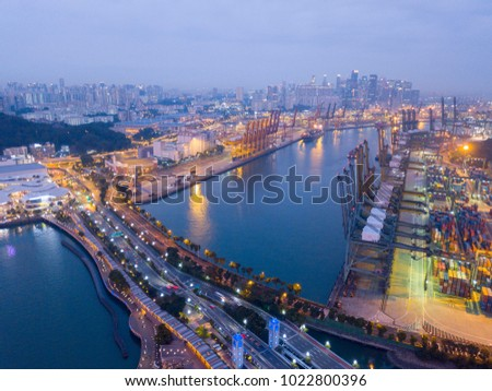 aerial shot of port of singapore at night. transportation and logistic concept #1022800396