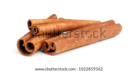 Cinnamon sticks isolated on white background Royalty-Free Stock Photo #1022859562