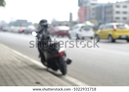 Motorcycle blurring on the highway. #1022931718