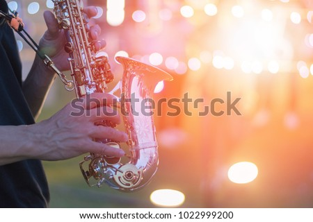 World Jazz festival. Saxophone, music instrument played by saxophonist player musician in fest. #1022999200