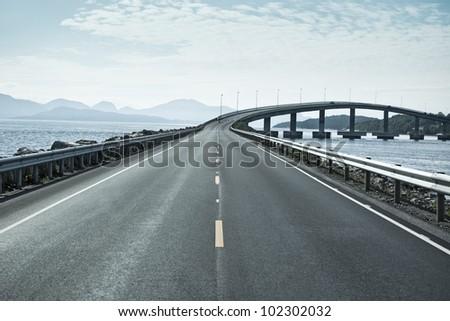 Modern bridge over islands in Norway. #102302032