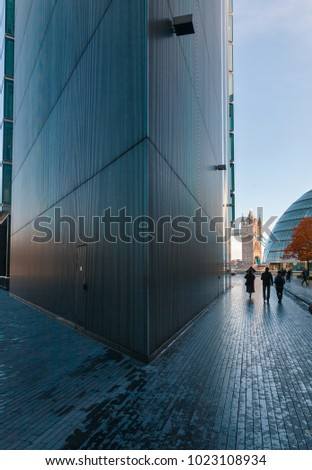 LONDON, UK - NOV 1, 2012: Pedestrians walking along More London Riverside to London City Hall in a morning. Tower Bridge is seen in background #1023108934